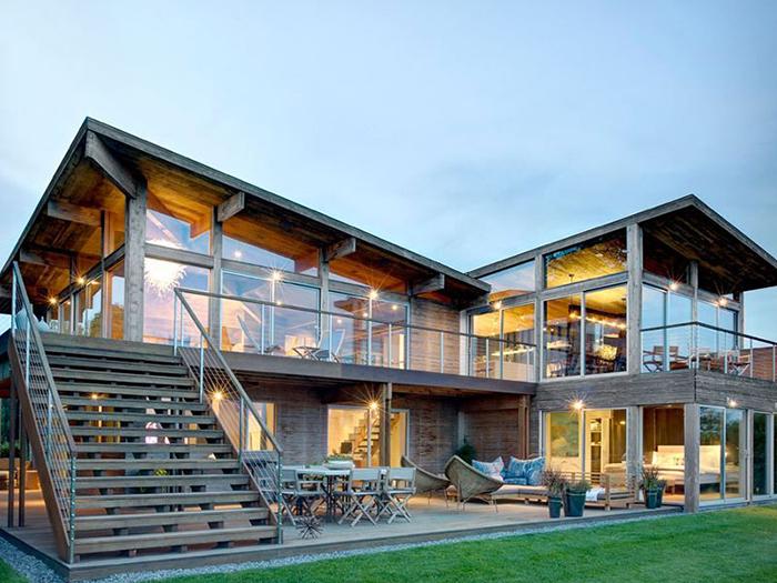Mẫu nhà thép dân dụng 2 tầng dân dụng được kết hợp độc đáo cùng gỗ giúp tạo không gian xanh cho ngôi nhà của bạn