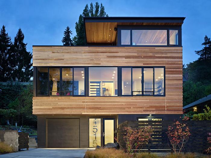 Mẫu nhà thép 2 tầng kết hợp độc đáo giữa khung thép và tấm ốp gỗ cùng kính tạo vẻ đẹp sang trọng, khẳng định đẳng cấp cho gia chủ